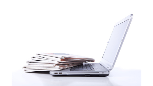 Magazines on a laptop